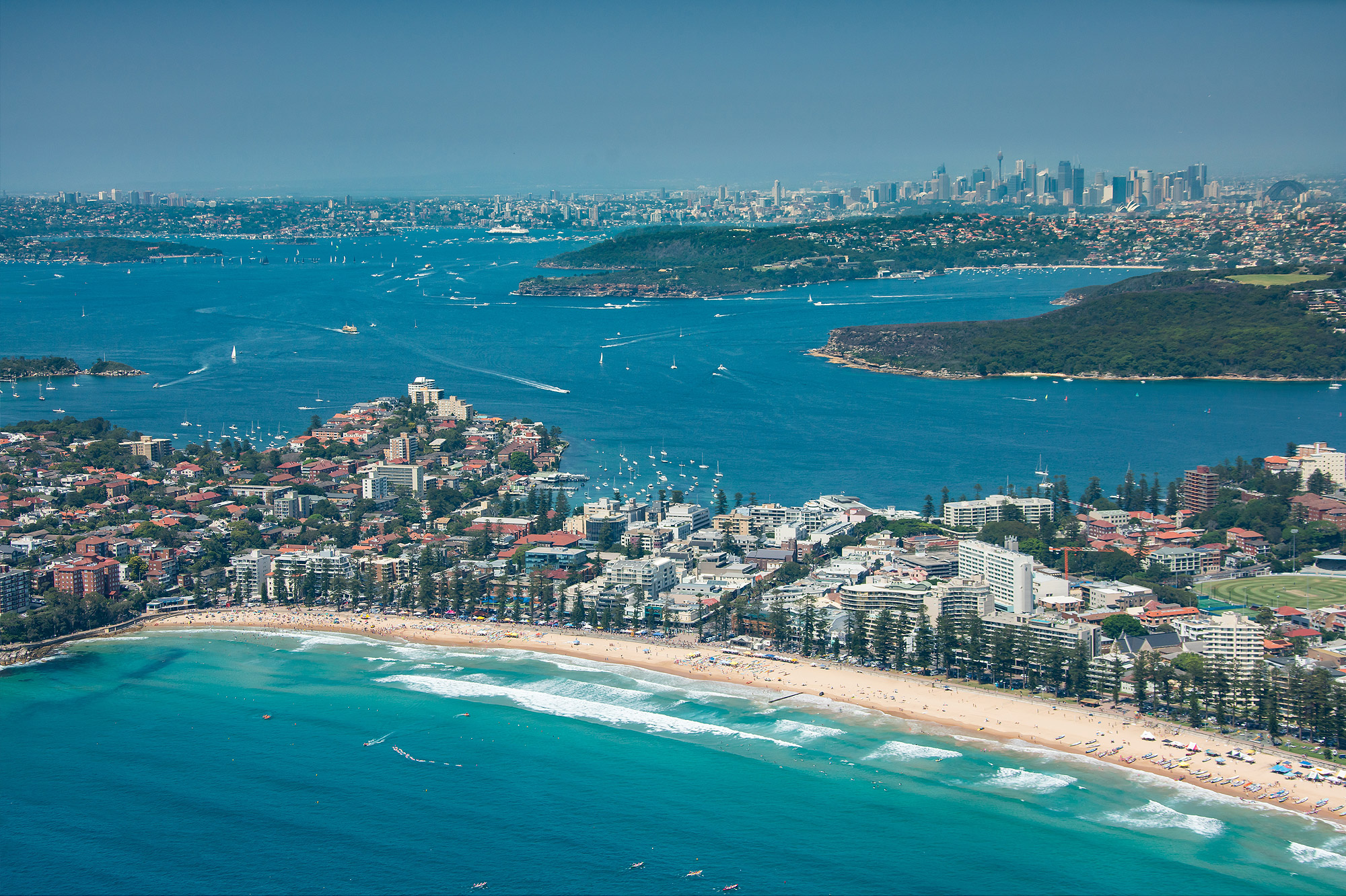 Aerial view over Manly Beach towards the city